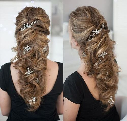 wedding curly downdo with hair flowers