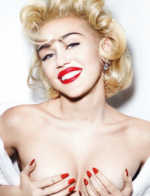 Miley Cyrus medium blonde curly hairstyle