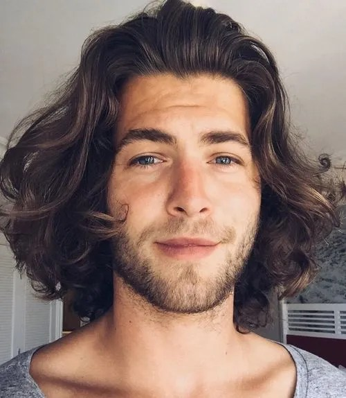 medium men's hairstyle for curly hair