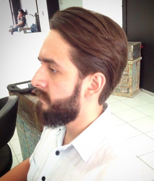 mens medium slicked back hairstyle