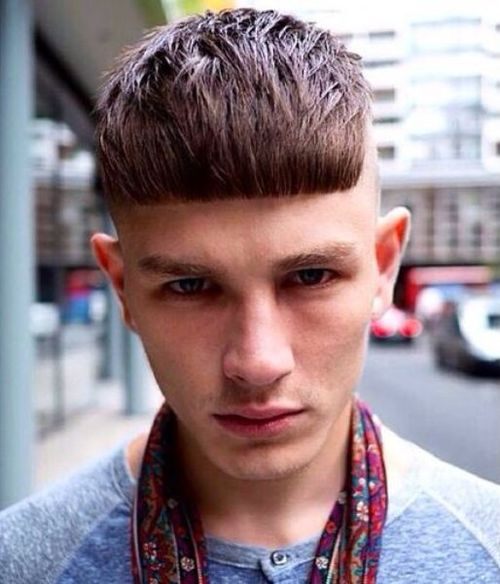 Shaved sides men hairstyle with textured top