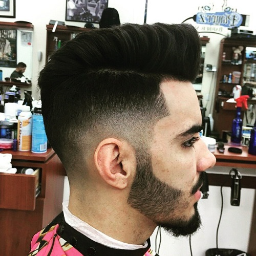 mens faux hawk with side and back fade