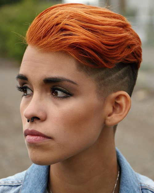 red hairstyle with side undercut for women