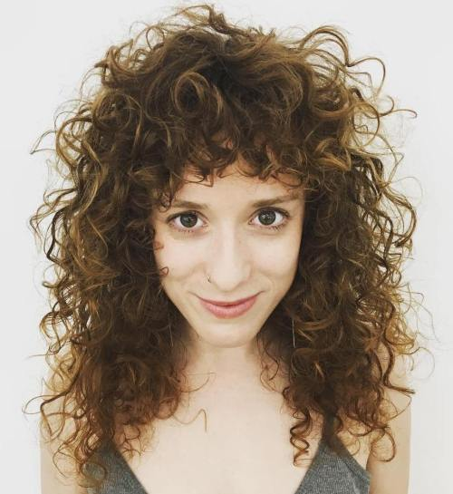 layered haircuts for curly hair with bangs 40 styles featuring curly hair with bangs 4653