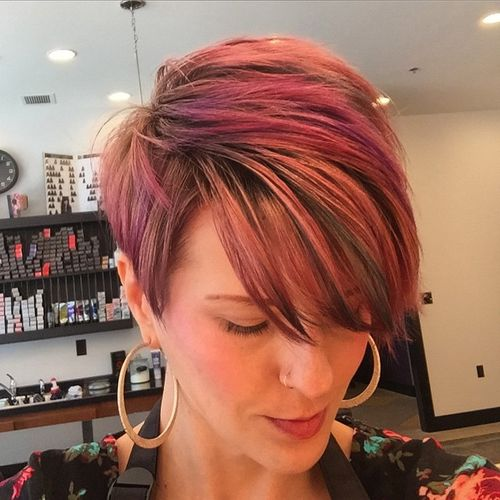 pastel red pixie with long bangs