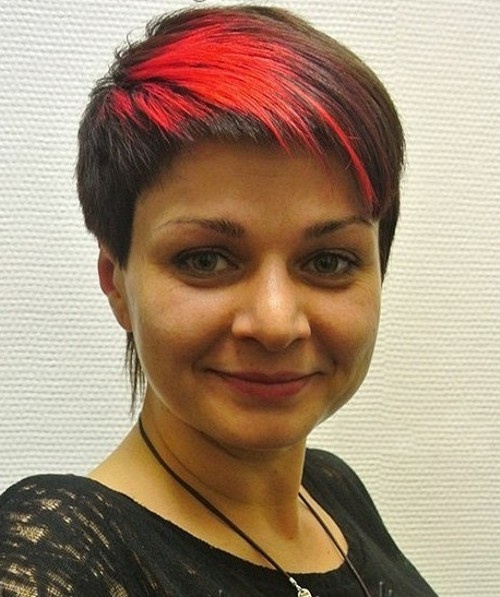 short pixie with red highlights in the bangs