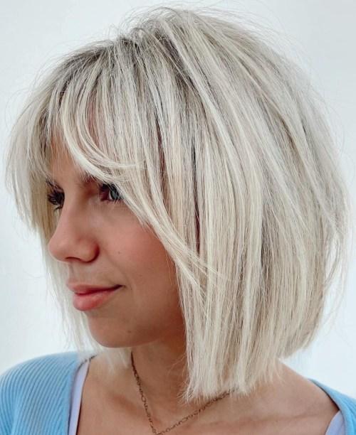 Platinum Blonde Bob with Face Framing Bangs