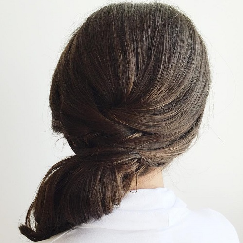 Brunette Side Ponytail With A Criss Cross Detail