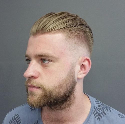 long top short sides men's hairstyle with a beard
