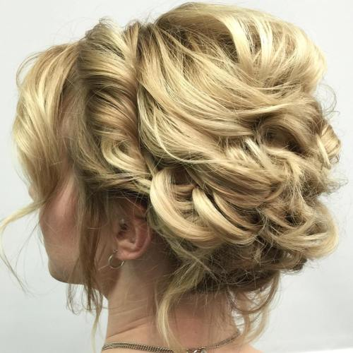 One of the easy updos for short hair is this cute little bun, enchanting and elegant. The hair around the crown is teased for an extra body, and the bottom hair is loosely twisted into a soft round bun, while the bangs are slightly curled to bring a playful element into the finished look.