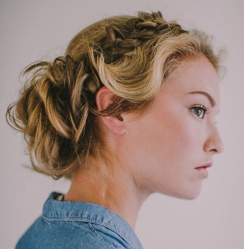 blonde curly updo with a side braid