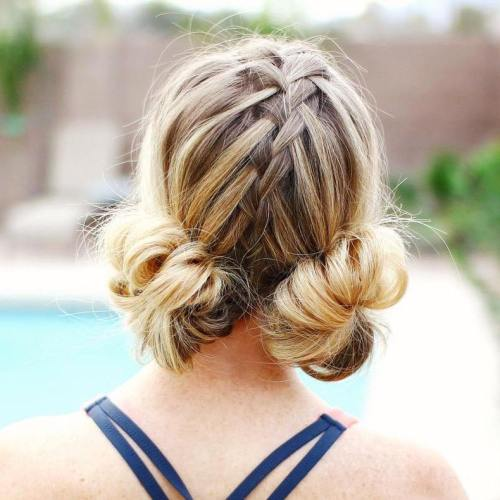 Two Low Buns With A Centre Braid