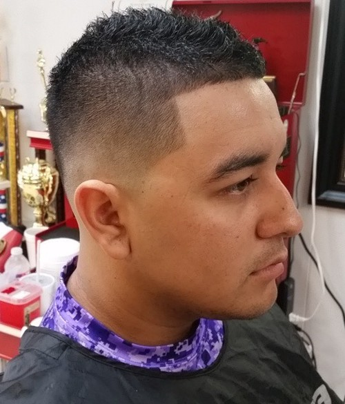 short Mohawk into fade haircut