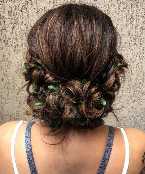 Low Messy Looped Updo