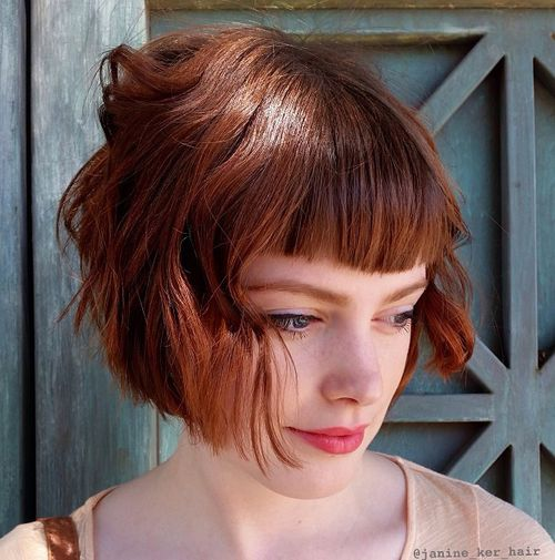 short red wavy bob with bangs