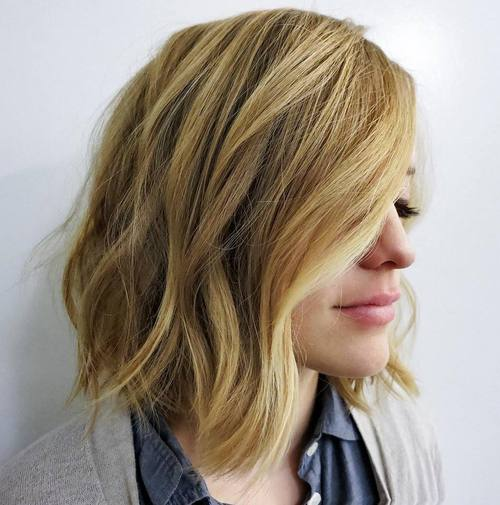 blonde side parted lob with loose waves