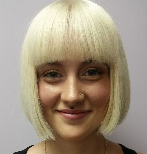 blunt blonde bob with straight bangs