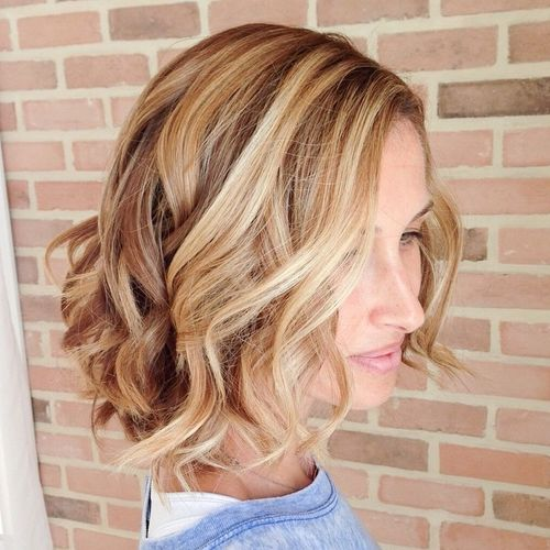 caramel short bob with blonde highlights