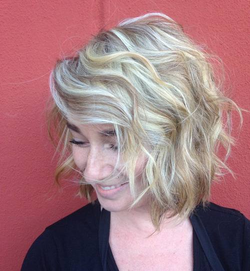 wavy messy blonde bob with bangs