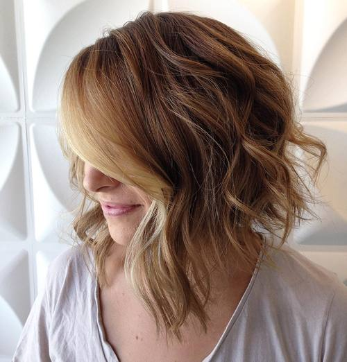 long wavy asymmetrical bob with balayage