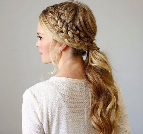 messy double braid and low pony