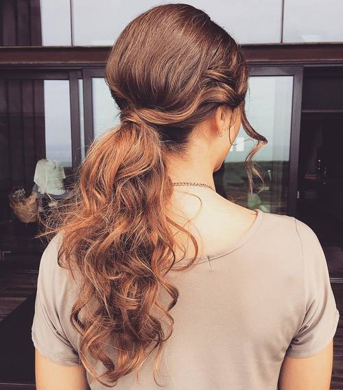long curly messy ponytail