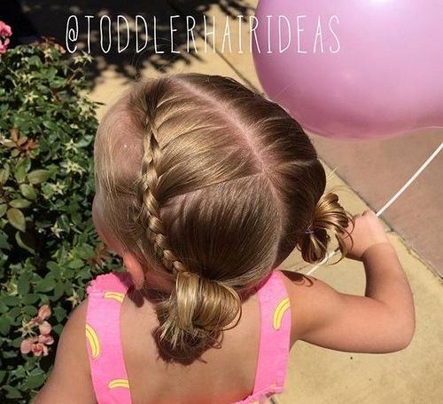 braided baby hairstyle with pigtail buns