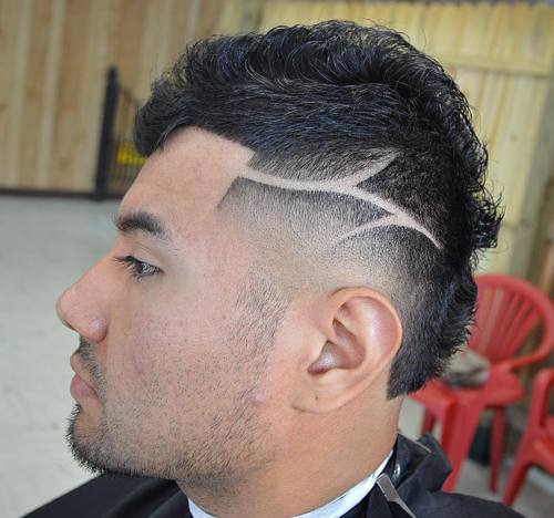 taper fade Mohawk with shaved designs