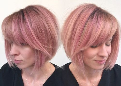 pastel pink bob with darkened roots