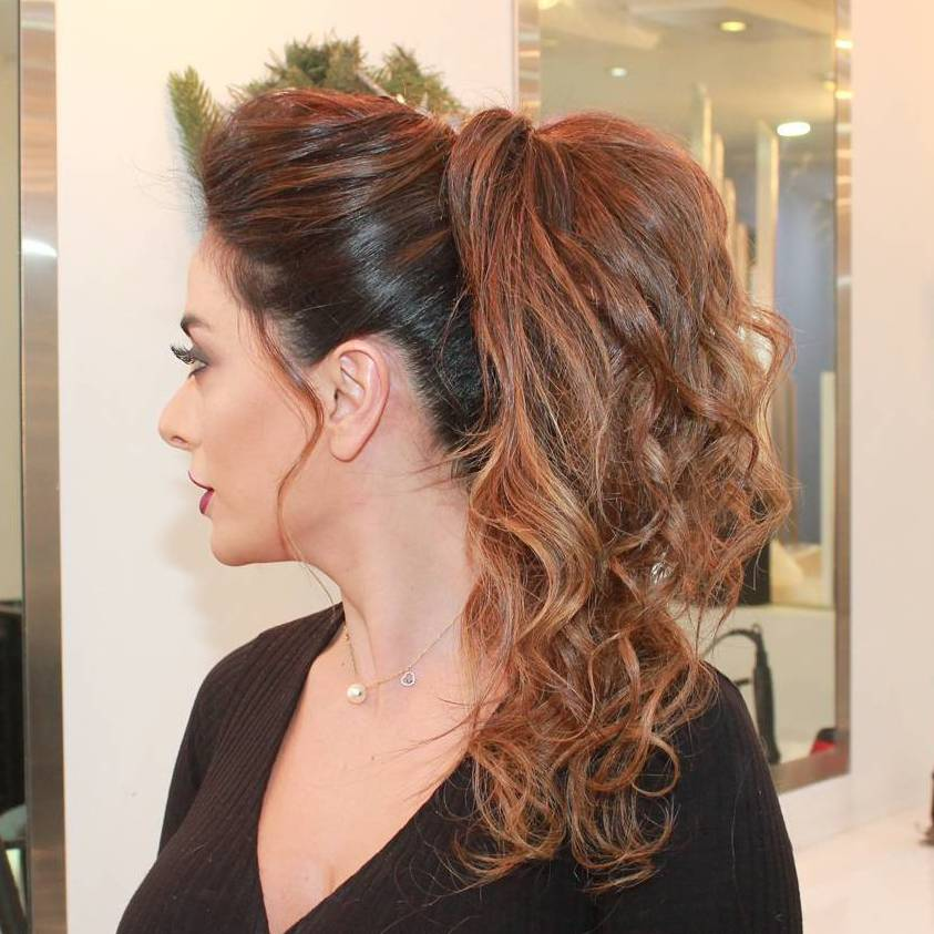 30 eye catching ways to style curly and wavy ponytails curly messy ponytail pmusecretfo Image collections