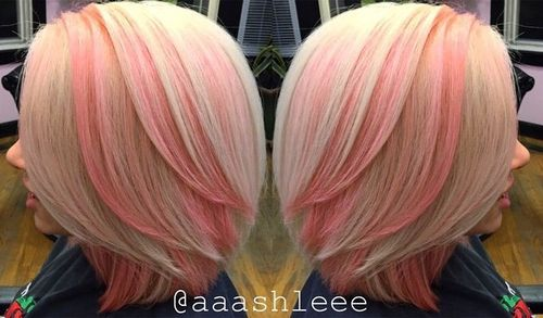 blonde bob with flamingo pink highlights
