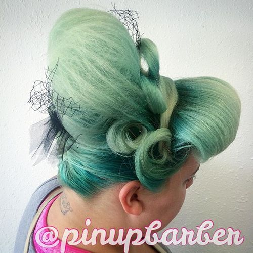 pastel green hair with beehive updo