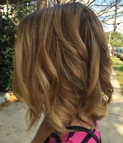 medium light golden brown hair with dark roots