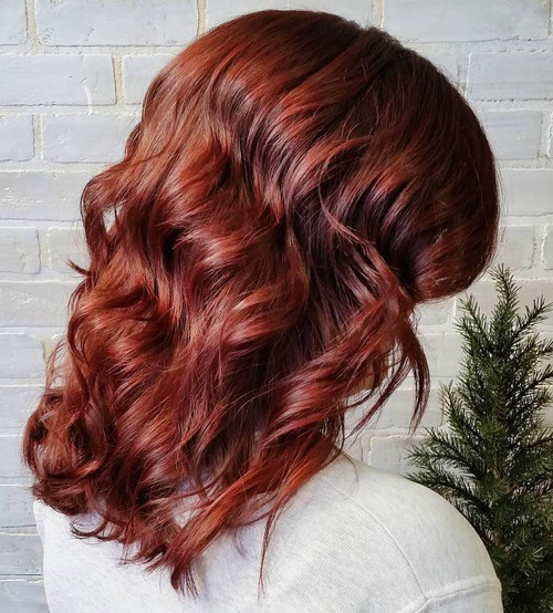 mid-length shiny auburn waves hairstyle