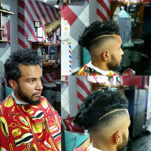 short sides long curly top men's hairstyle