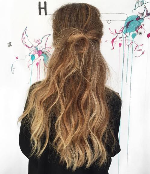 Messy Half Updo For Long Wavy Hair