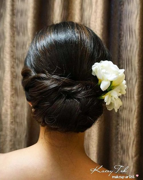 polished chignon with hair flowers