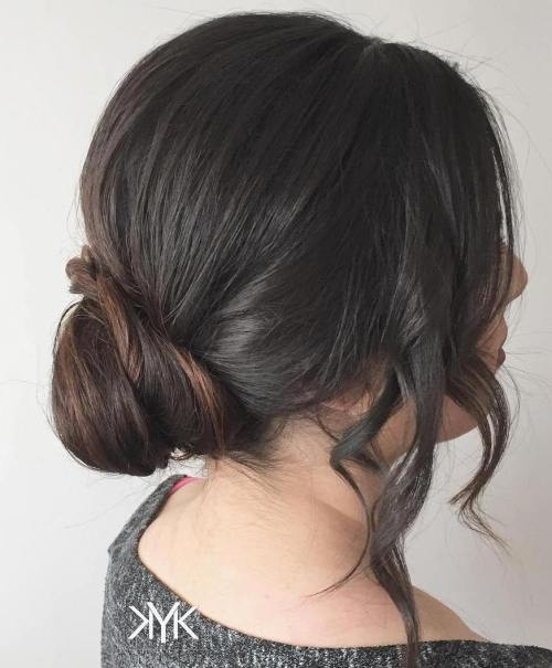 low bun with face framing locks