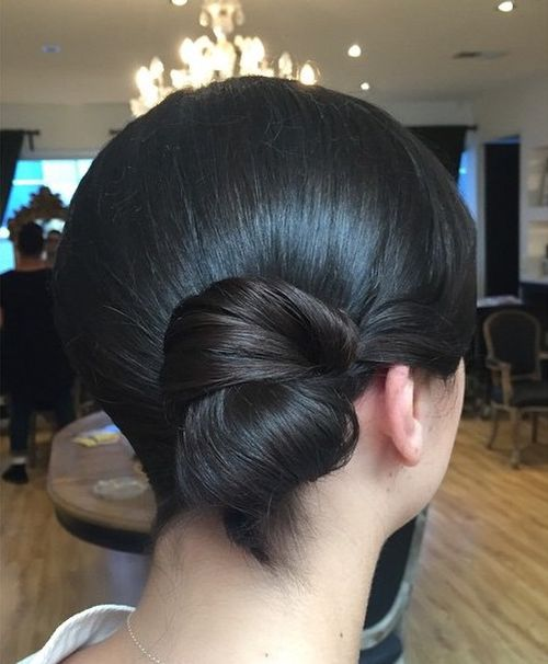 formal polished low side bun for medium hair