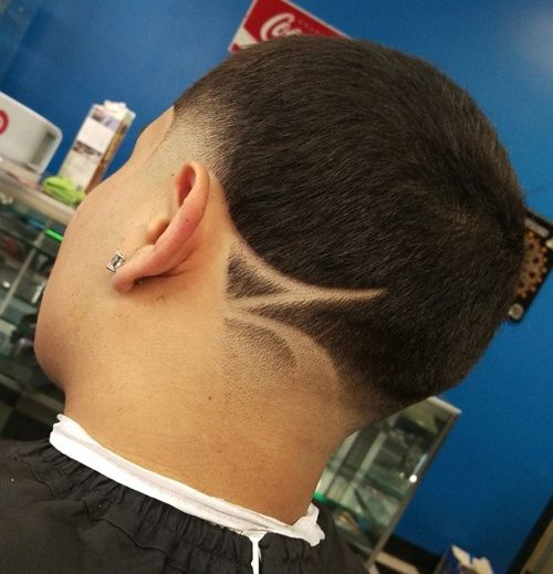 buzz cut with shaved design and faded temple