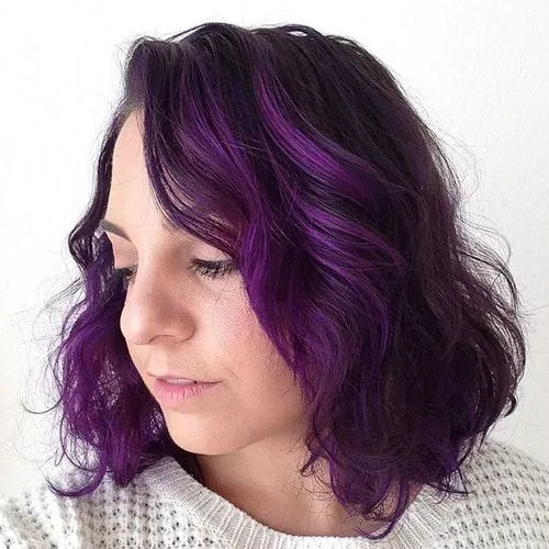 dark brown hair with bright purple highlights