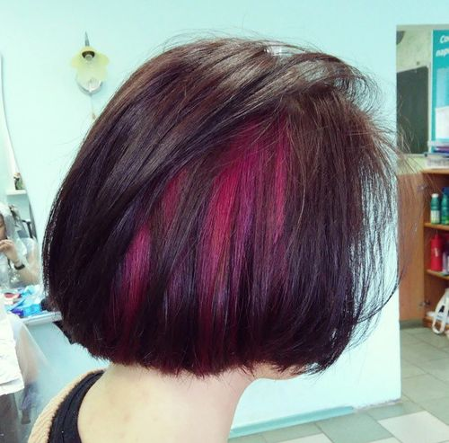dark brown bob with magenta peekaboo highlights