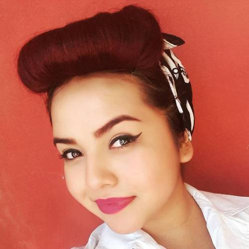 brunette pin up hairstyle with a scarf