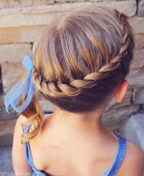 twisted crown updo with a side ponytail for toddlers