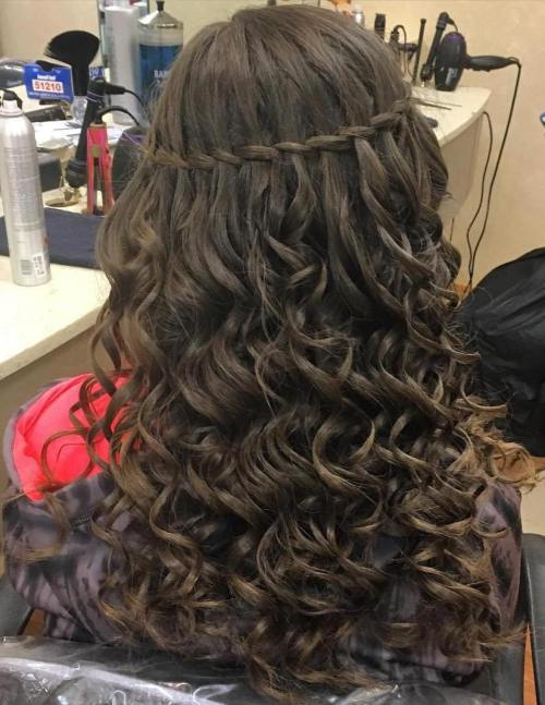 long curly hairstyle with a thin waterfall braid