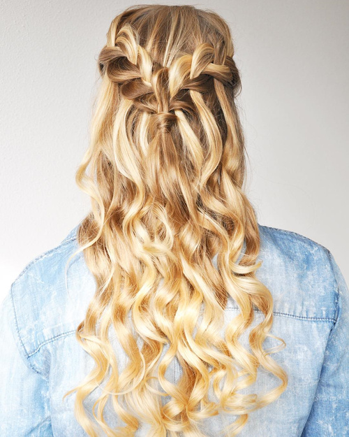 half updo with a dutch waterfall braid