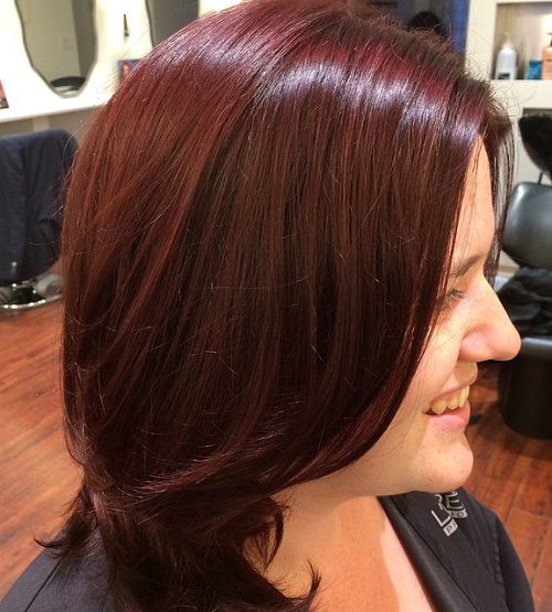 medium layered mahogany hairstyle