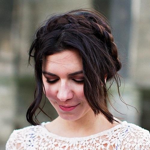 messy brunette milkmaid braid updo