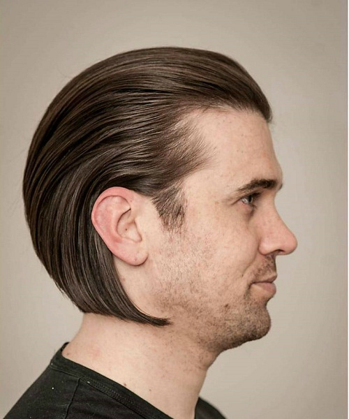 Captivating Medium Slicked Back Hairstyle For Men