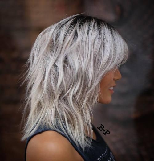 Medium Layered Hairstyle With Bangs